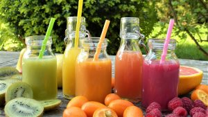 4 fresh smoothies in glass bottles